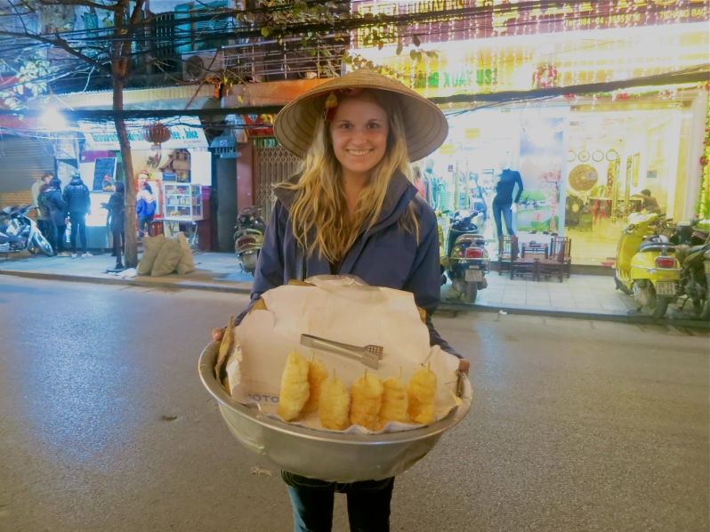 Our first tourist scam. A seemingly lovely Vietnamese lady approached me, placing her hat on my head and her basket in my hands and taking photos. It was all fun and games until she demanded me to buy every single one of her doughnuts.