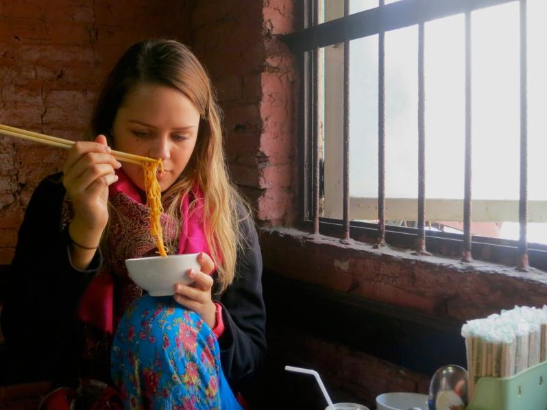 Emily enjoying New Day noodles