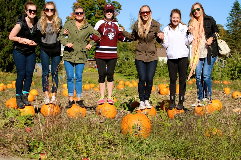 Girls on pumpkins