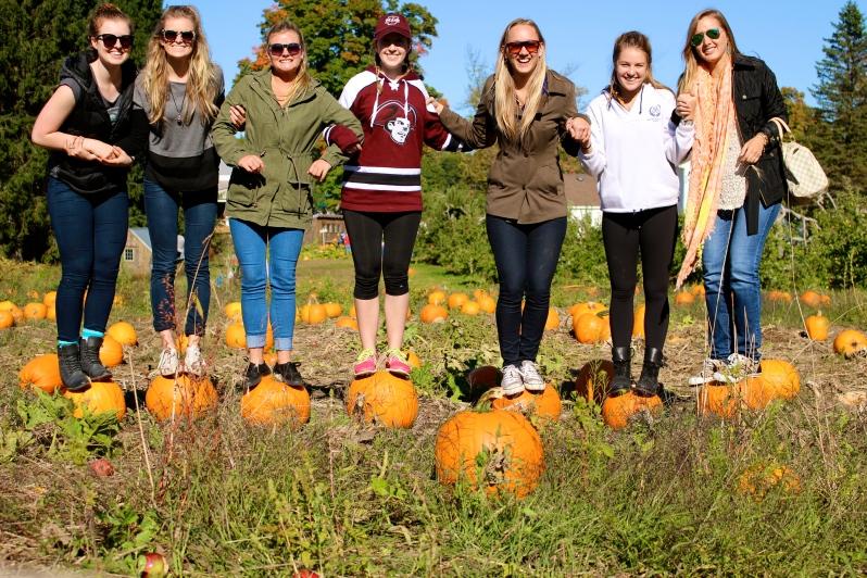 Girls on pumpkins